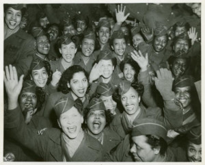 "Home again, Photographs and Prints Division (Military Photograph Collection), Schomburg Center for Research in Black Culture Caption on back: ""After almost fourteen months overseas in England and France the Wacs pictured above were happy to be home. They arrived from France on Friday, March 8th and landed at Staten Island Terminal of the New York Port of Embarkation. They were among the last contingent of the 6888th Central Postal Directory to return from overseas. 3/13/46."""